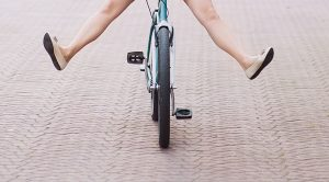 female with legs out on bicycle