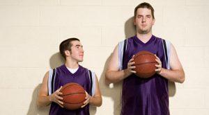 short man and tall man with basketballs